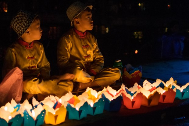 Young children selling lanterns