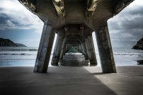 Standing under the wharf at Tolaga Bay